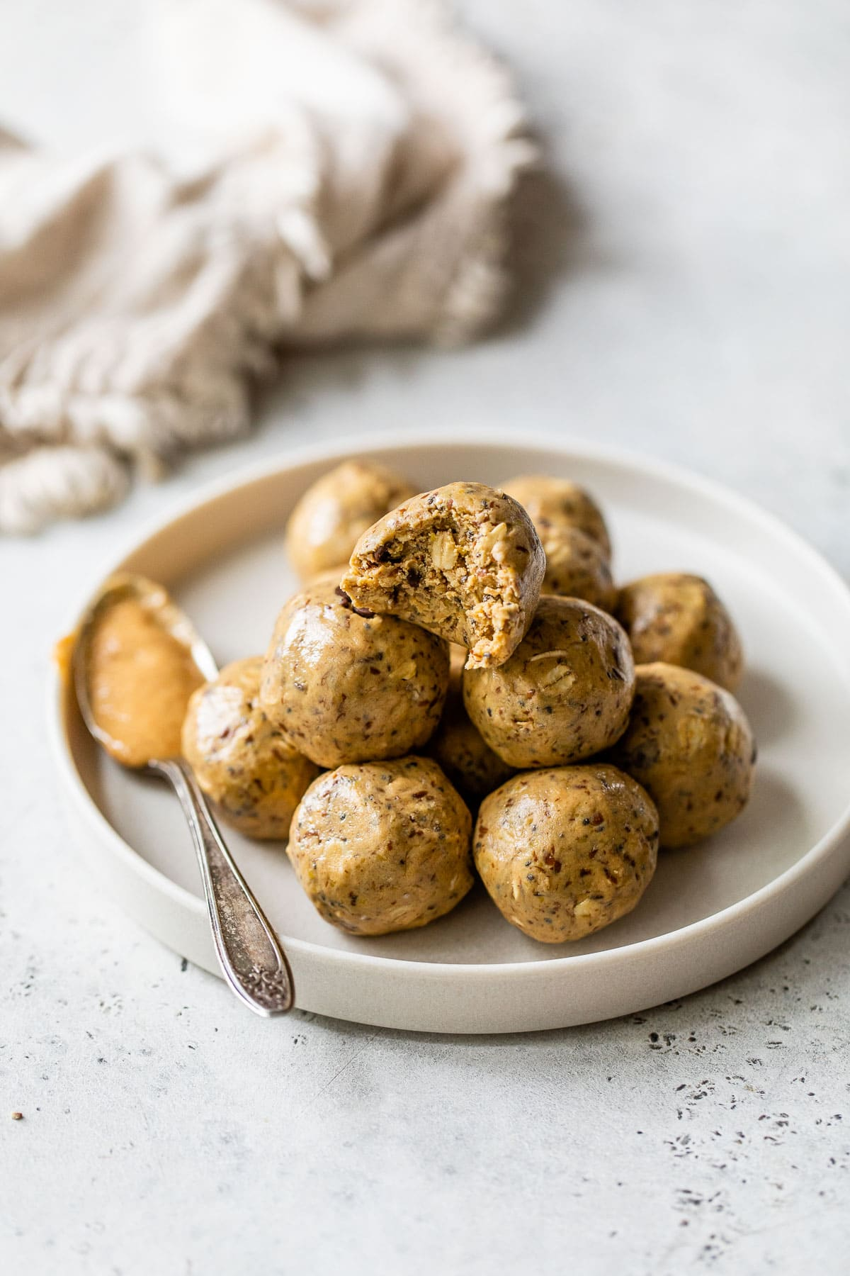 peanut butter protein balls piled on a plate