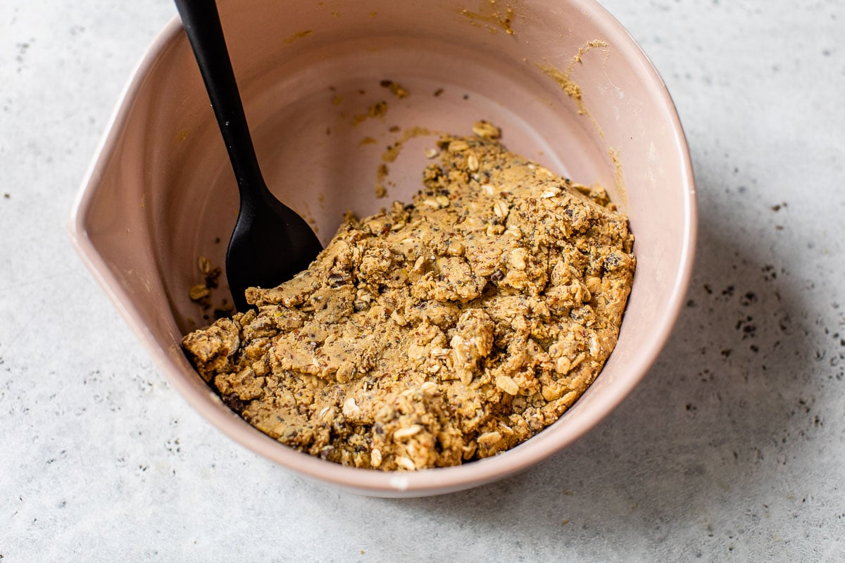 peanut butter mixed with honey, oats, and protein powder mixed in a bowl