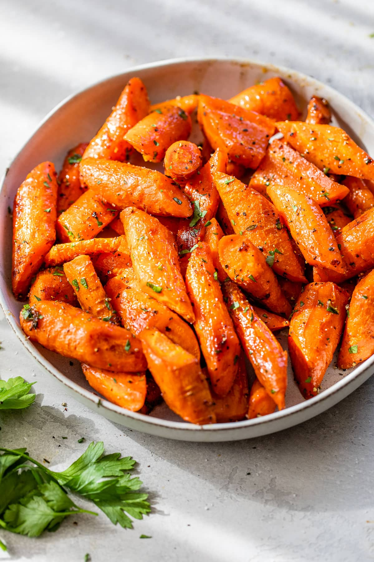 roasted carrots with herbs in a bowl