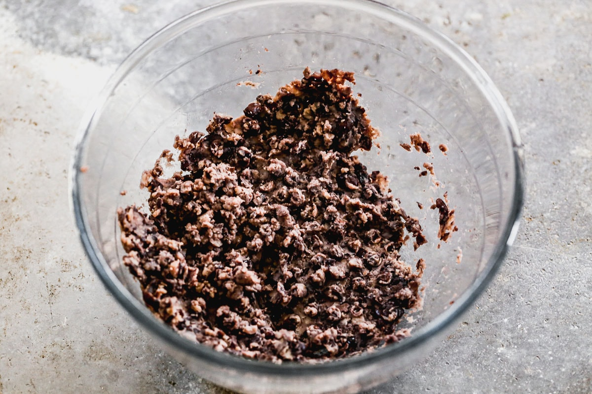 mashed black beans in a glass bowl