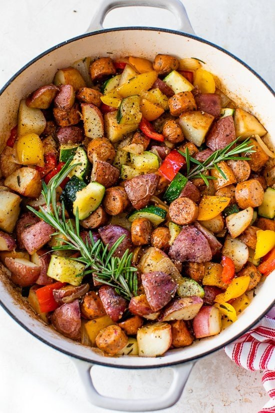 one-pot skillet dinner made with chicken sausage, bell peppers, zucchini, baby red potatoes and fresh herbs.