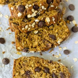healthy pumpkin chocolate chip bread with oats sliced on parchment paper