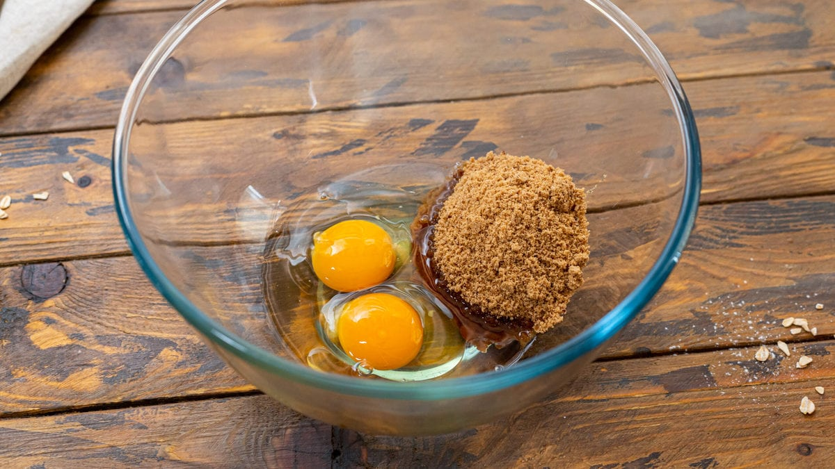 Eggs, coconut oil, and brown sugar in a bowl