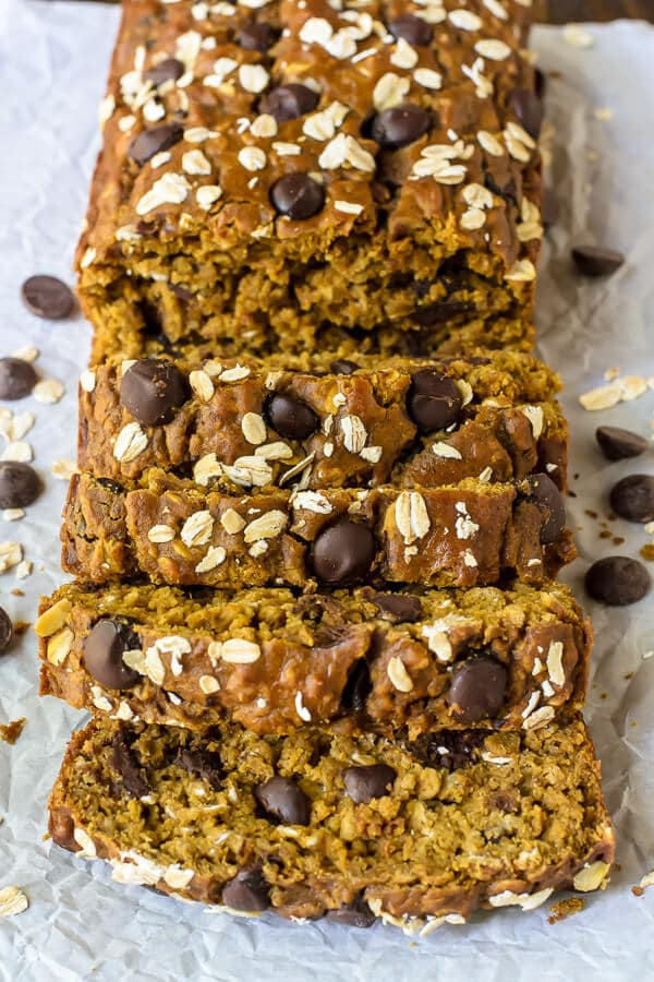 Perfect Pumpkin Chocolate Chip Bread topped with oats and sliced on parchment paper