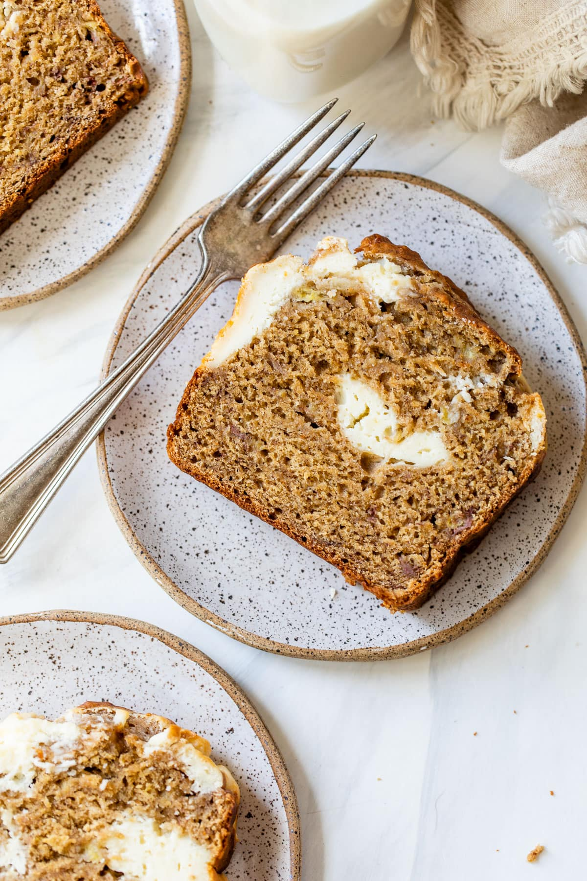 slices of cream cheese banana bread on plates