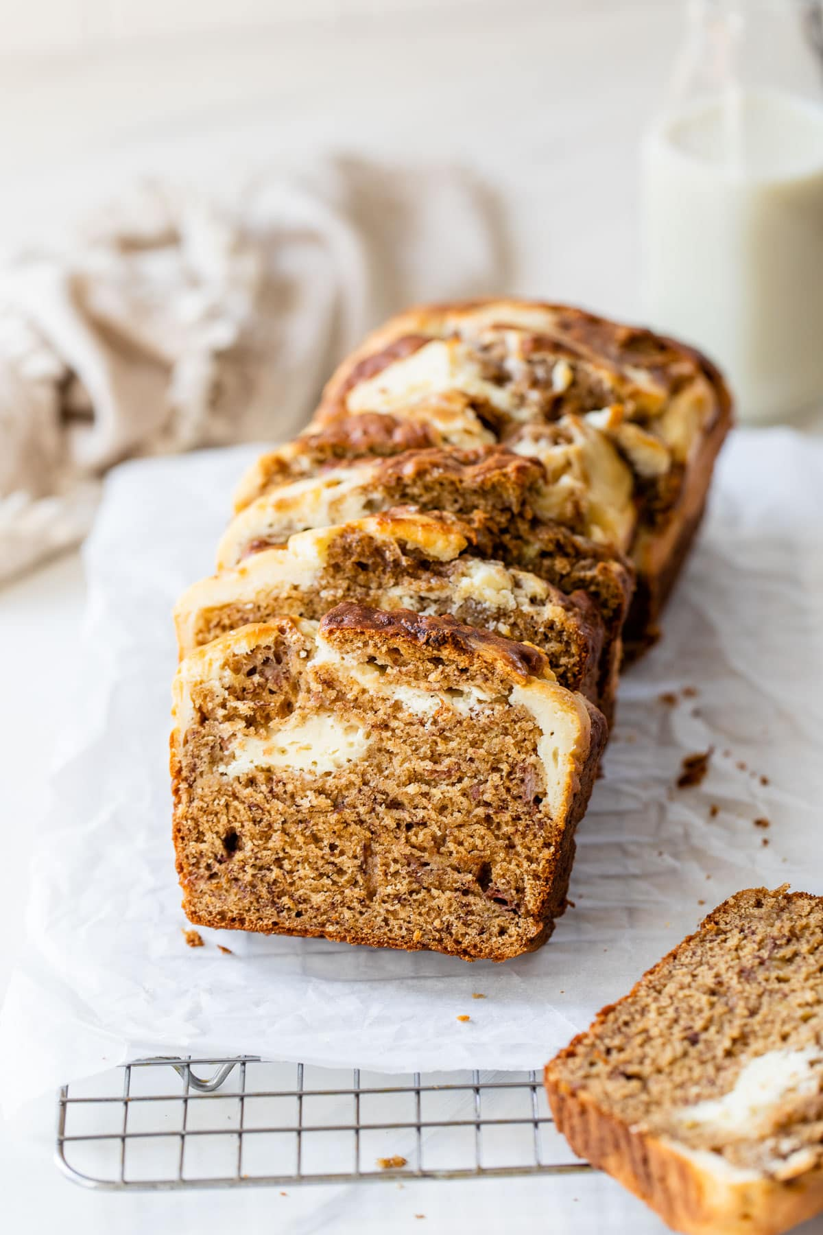 a loaf of sliced banana bread with cream cheese swirls