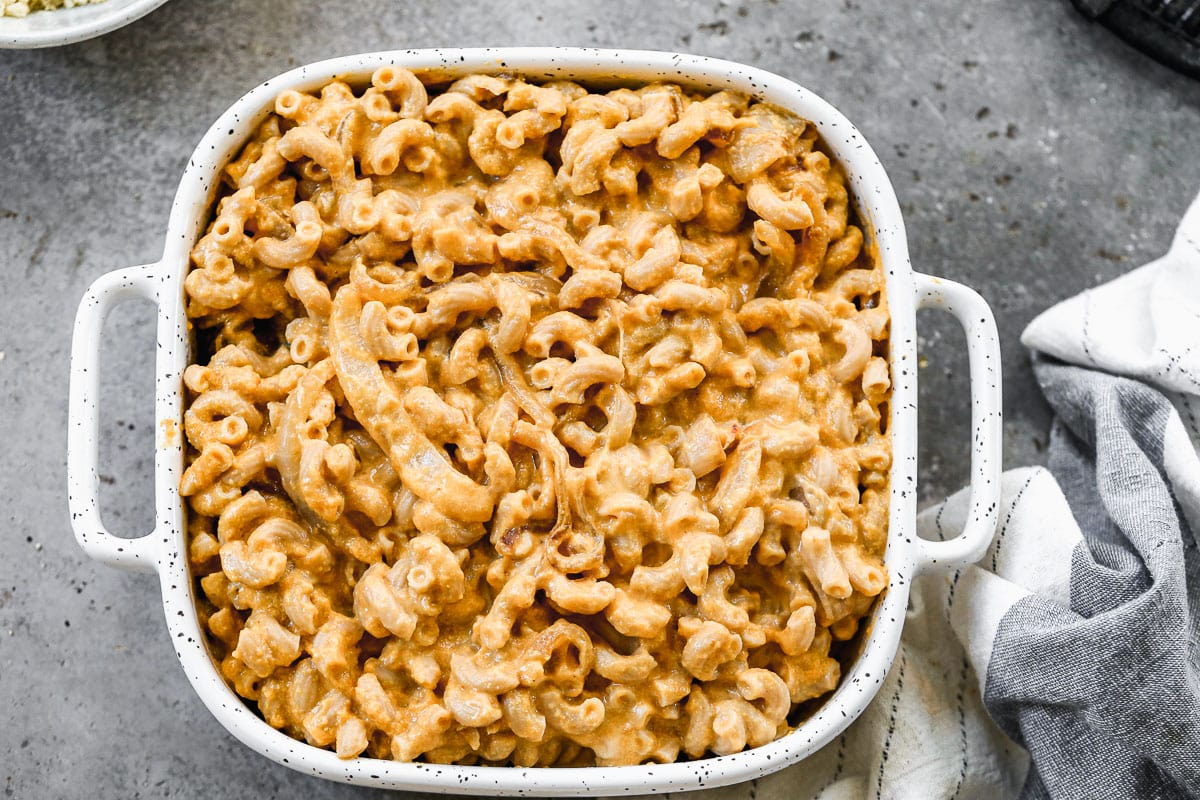 A casserole dish of healthy pumpkin mac and cheese ready to be baked
