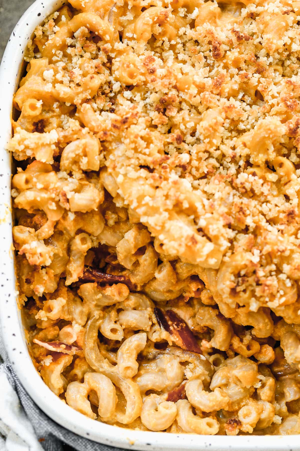 a close up shot of tasty pumpkin mac and cheese with bacon and breadcrumbs