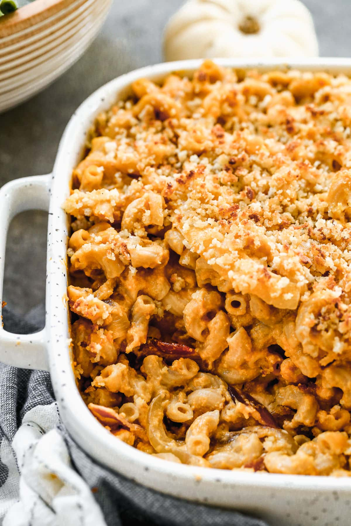 a casserole dish with healthy pumpkin mac and cheese